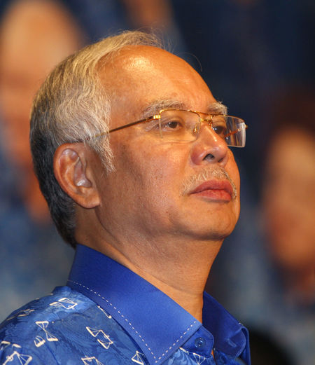 Malaysian Prime Minister looks at party's supporters after winning the general election 06 May 2013. 1MDB Leader Politics South East Asia Adult Barisan_nasional Close-up Election Eyeglasses  Headshot Looking Away Malaysia Males  Mature Adult Mature Men Men Najib Razak One Person Portrait Prime Minister Real People Umno
