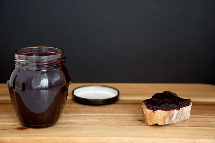 Food And Drink Table Food Still Life Indoors  Freshness Wood - Material Sweet Food Close-up No People Jar Indulgence Sweet Ready-to-eat Black Background Breakfast Bread Jam Blueberry Jam Black Wooden Focus On Foreground