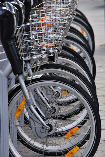 Basket Bicycle Bicycle Basket Black Color City Close-up Day Focus On Foreground High Angle View Land Vehicle Metal Mode Of Transportation No People Outdoors Spoke Stationary Street Technology Transportation Wheel