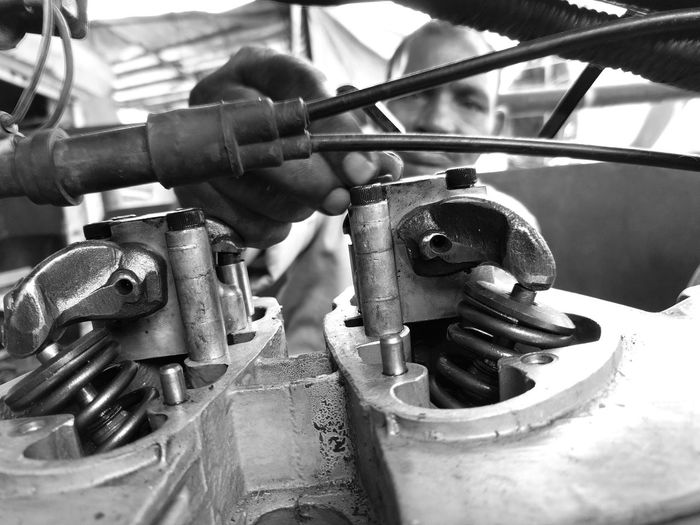 Close-up Metal Focus On Foreground Extreme Close Up Outdoors Motorcycles Street Photography Royal Enfield Motorcycle Maintenance Working With Hands Close-up Metal Focus On Foreground Outdoors Extreme Close Up Dramatic Angles Black And White Photography Black And White Second Acts