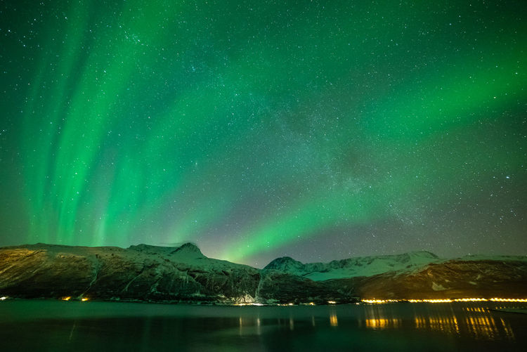 Aurora Borealis in Norway Geomagnetic Disturbance Kp-index Night Photography Northern Lights Polar Lights Astronomy Beauty In Nature Fjord Geomagnetic Storm Green Color Idyllic Lake Mountain Mountain Range Nature Night Reflection Scenics - Nature Sky Snowcapped Mountain Solar Storm Space Tranquility Water Waterfront
