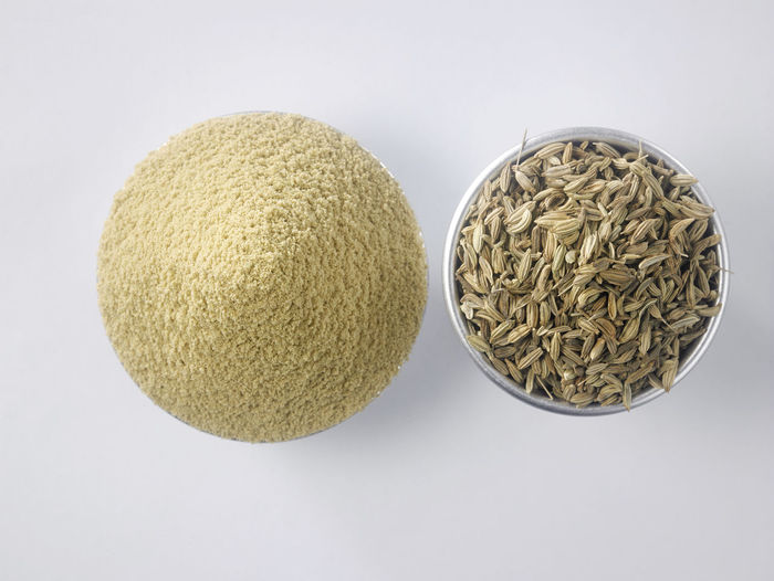 top view of the cumin seeds and cumin ground Container Herb Natural Aluminum Aroma Bowl Close-up Condiment Cumin Directly Above Dry Flavor Food Food And Drink Fragrance Ground - Culinary Healthy Eating Indoors  Ingredient No People Raw Food Seasoning Spice Still Life Studio Shot