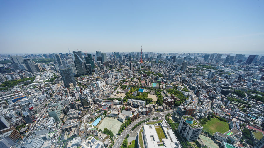 High angle view of modern city buildings against clear sky