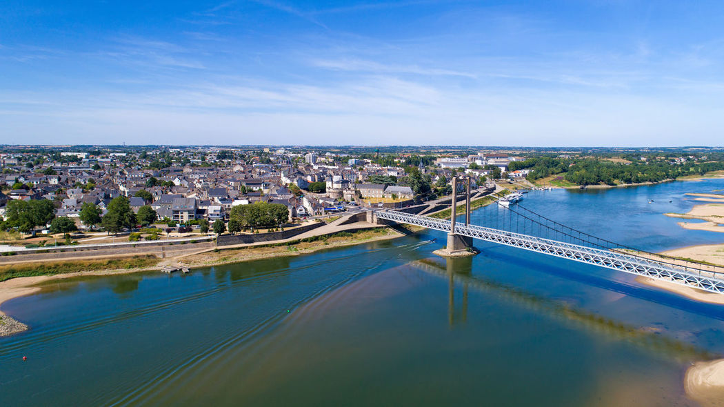 Aerial view on Ancenis city and the Bretagne-Anjou bridge, Loire Atlantique, France Bretagne Castle City City Center Cityscape Drone Shot EyeEm Best Shots EyeEm Selects France Aerial Photography Aerial View Ancenis Anjou Bridge - Man Made Structure Day La Loire Landscape Loire Atlantique River Suspended Bridge Suspension Bridge Water