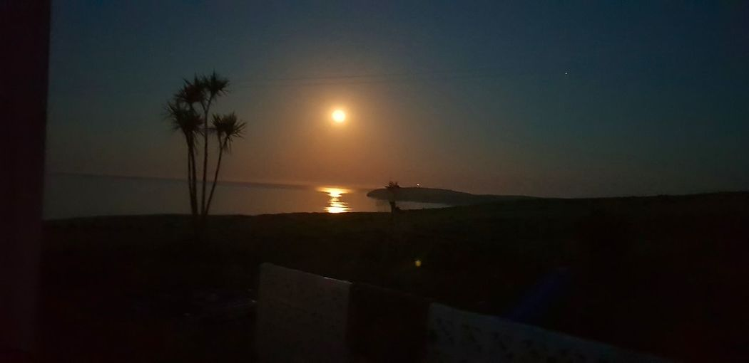 copper moon at Mull of Galloway Moon Moonlight Moon_collection Moon Shots Copper Moon Taking Pictures Taking Photos Drummore Dumfries And Galloway Mull Of Galloway Scotland Coastline Beachphotography Peaceful Peace Night Nightphotography Moonrise Tree Moon Illuminated Sky Palm Tree Full Moon Horizon Over Water Planetary Moon Calm Silhouette Astrology Ocean The Great Outdoors - 2018 EyeEm Awards The Traveler - 2018 EyeEm Awards