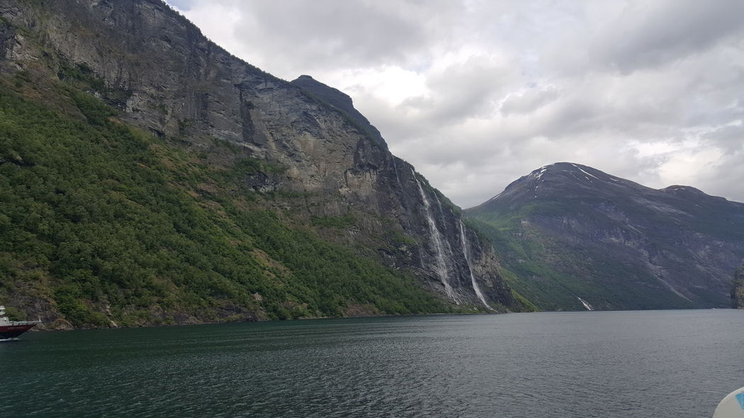 The Geiranger Fjord (Norwegian: Geirangerfjorden) is a fjord in the Sunnmøre region of Møre og Romsdal county, Norway. It is located entirely in the Stranda Municipality. It is a 15-kilometre (9.3 mi) long branch off of the Sunnylvsfjorden, which is a branch off of the Storfjorden (Great Fjord). The small village of Geiranger is located at the end of the fjord where the Geirangelva river empties into it. Fjord Fjord-spotting Fjordland Fjordland Norway Fjordnorway Fjords Fjordsofnorway Fjordsshot Fjørd Geiranger Geiranger Fjord Geirangerfjord Geirangerfjorden Nature Nature On Your Doorstep Nature Photography Nature's Diversities Nature_collection Nature_perfection Naturelovers Naturephotography Norway Scandinavia Scandinavian The Purist (no Edit, No Filter)
