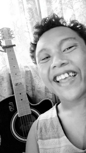 Person Guitar Comedy Missing Tooth Mising Blanckandwhite Handsome Boy Amazing View Adults Only Headshot Smiling Adult Young Adult Indoors  People Cheerful Happiness Day Close-up first eyeem photo