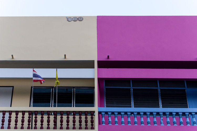 Low angle view of pink building against sky