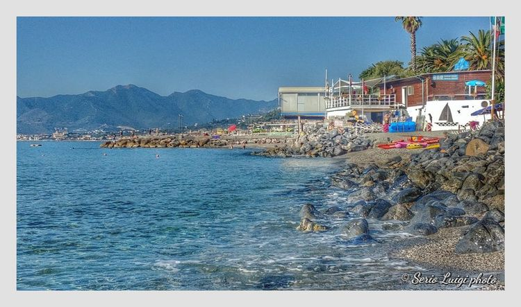 Relax in spiaggia, saluti da Borgio Verezzi (SV) Water Sea Clear Sky Beach Mountain Nautical Vessel Sand Sky Building Exterior Architecture