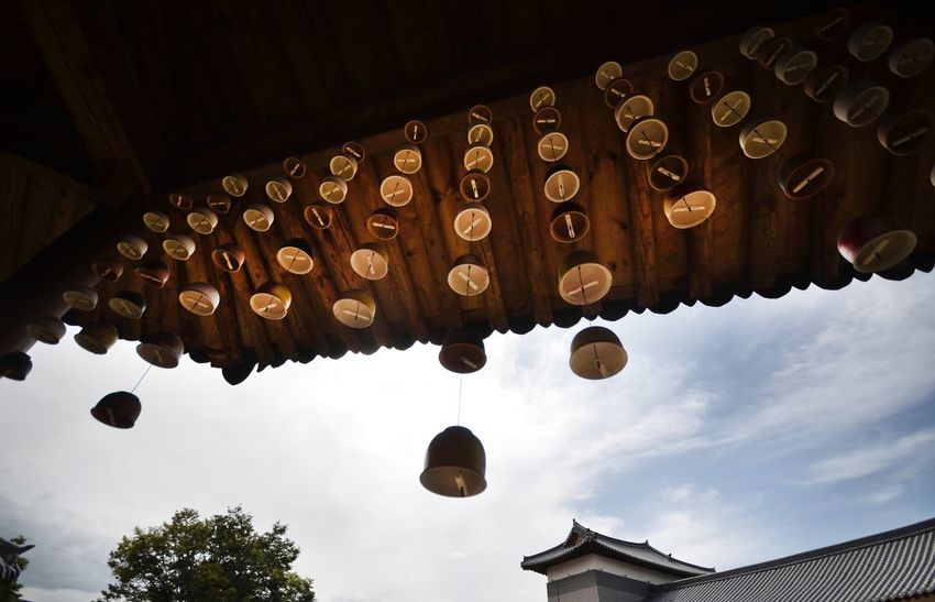 Bell Bell Korea Spirituality Religion Low Angle View Hanging Place Of Worship Cultures In A Row Day Building Exterior Hope Architecture Sky Outdoors Lantern No People Built Structure