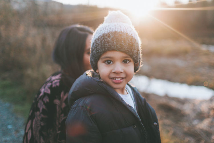 A happy little Indian boy, smiling at sunset. Indian Asian  Diverse Boy Child Smiling Winter Sunset Happy Portrait