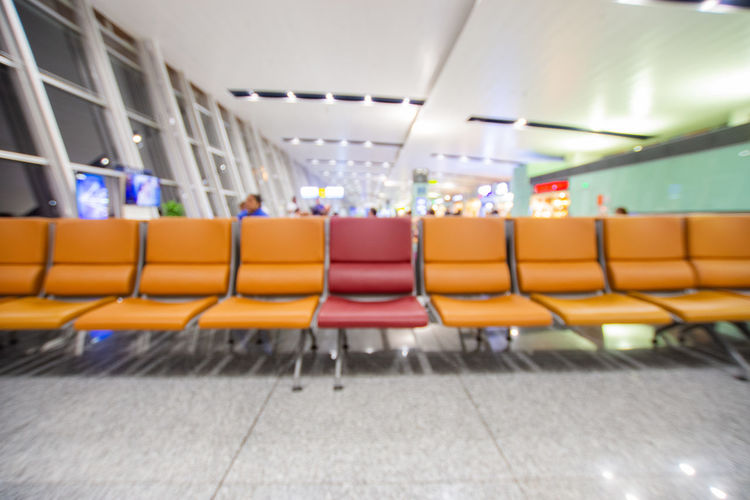 Seat Empty Absence Chair Transportation In A Row Indoors  No People Airport Public Transportation Illuminated Vehicle Seat Vehicle Interior Mode Of Transportation Architecture Travel Repetition Day Side By Side Orange Color Ceiling