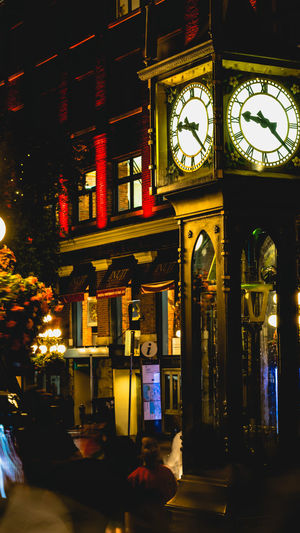 Steamclock Architecture Building Building Exterior Built Structure Business City City Life Clock Clock Face Communication Illuminated Instrument Of Time Lighting Equipment Night No People Outdoors Street Time Transportation Vancouver BC