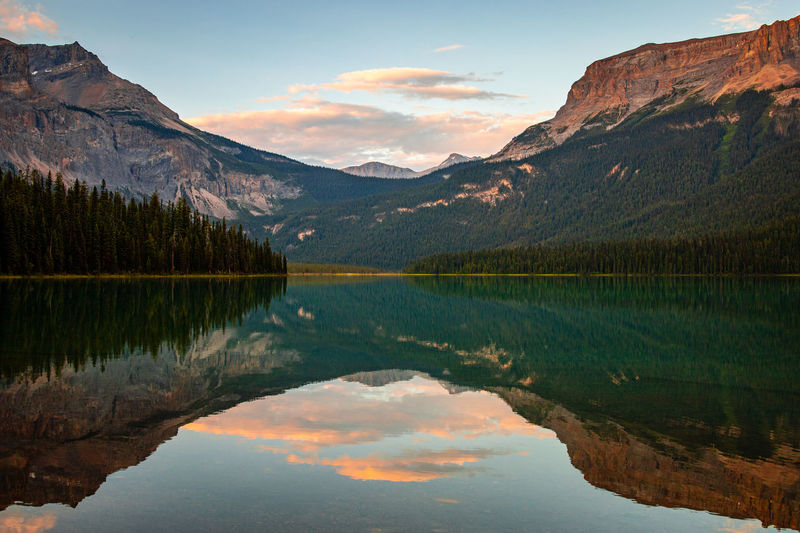 Beautiful mountain reflection on lake during golden hour