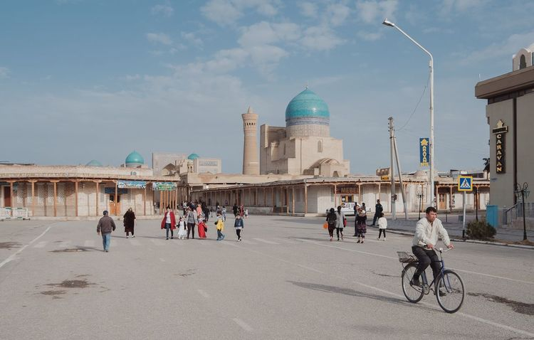 Beautiful view of Kalyan Minaret and Kalyan Mosque... Architecture Travel Destinations Building Exterior Real People Tourism Place Of Worship Day City Sky Clouds Street Uzbekistan Buxoro Bukhara Streetphotography Street Photography Cityscapes Urban Urbanphotography Fujifilmru Xf10-24mm Xt20 Fujifilm_xseries Bicycle Minaret