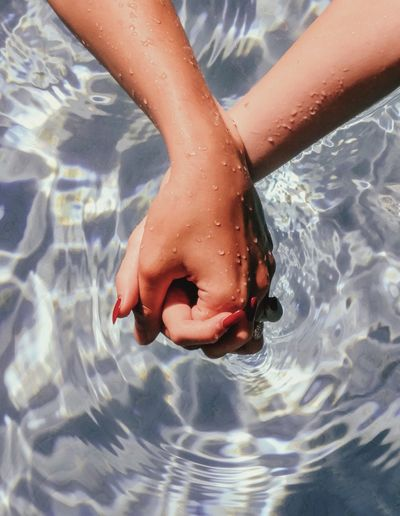 Low section of person in swimming pool
