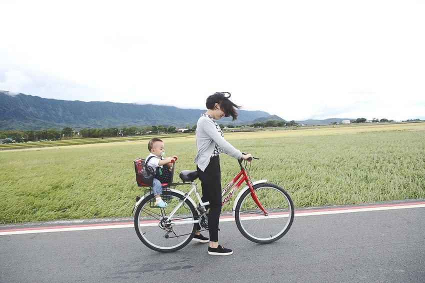 Taiwan Connected By Travel Bicycle Bonding Child Cycling Day Females Full Length Happiness Landscape Lifestyles Men Mountain Nature Outdoors Real People Riding Road Sky Sports Clothing Togetherness Transportation Two People Women Young Adult Young Women