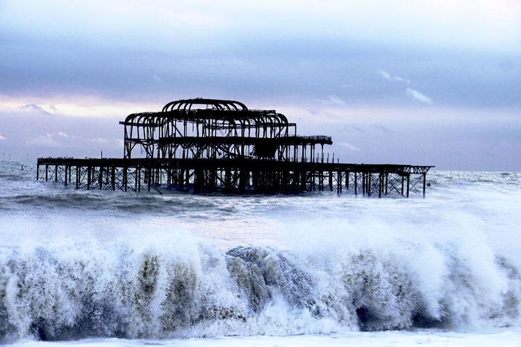 Water Sea Sky Architecture Pier Nature Motion Cloud - Sky Built Structure Wave No People Beauty In Nature Waterfront Scenics - Nature Day Splashing Aquatic Sport Damaged Outdoors Power In Nature Horizon Over Water Breaking Flowing Water The Art Of Street Photography