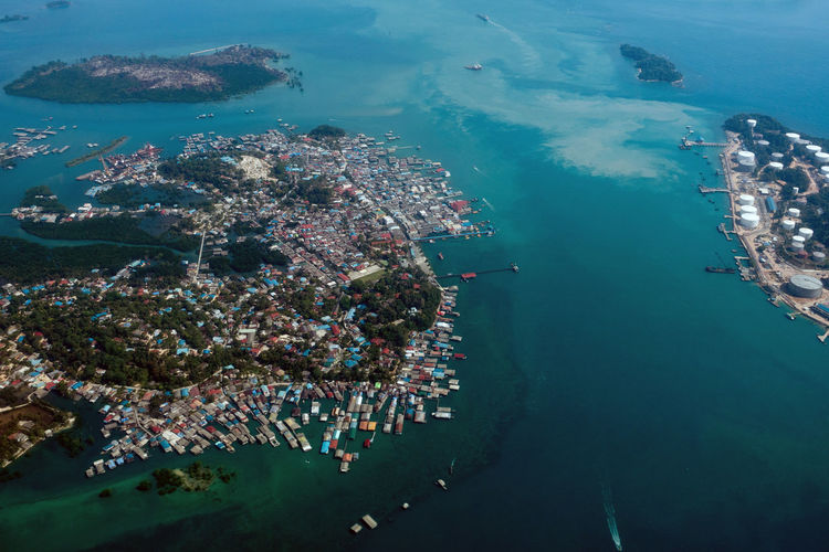 Aerial view of island by cityscape
