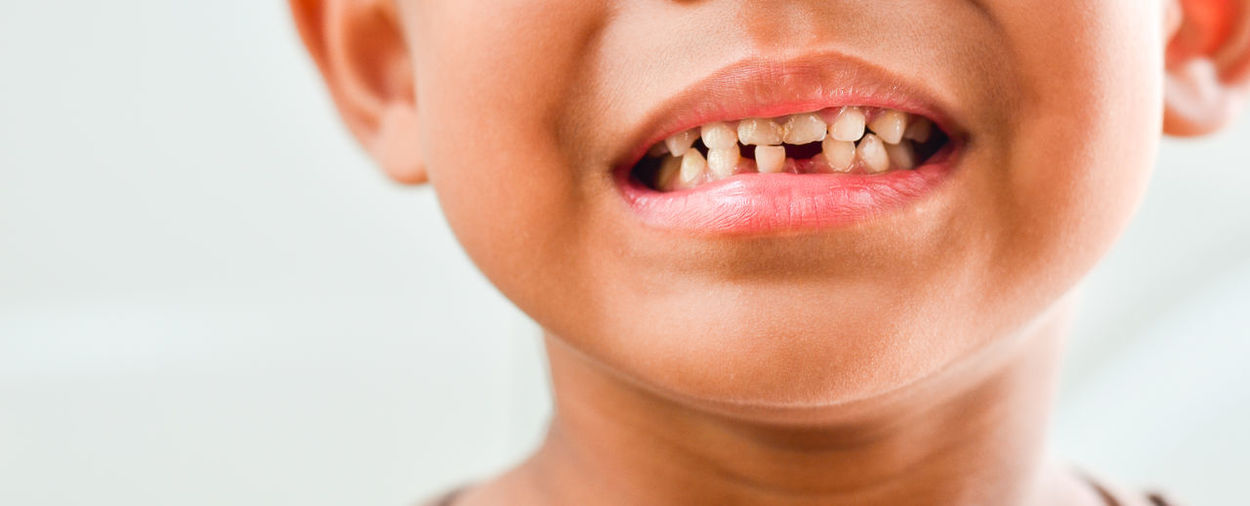 Midsection of smiling boy with gap tooth
