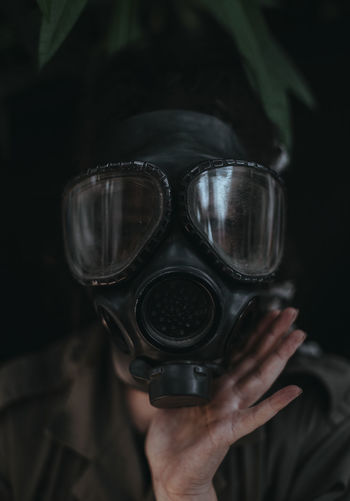 Portrait of woman wearing gas mask