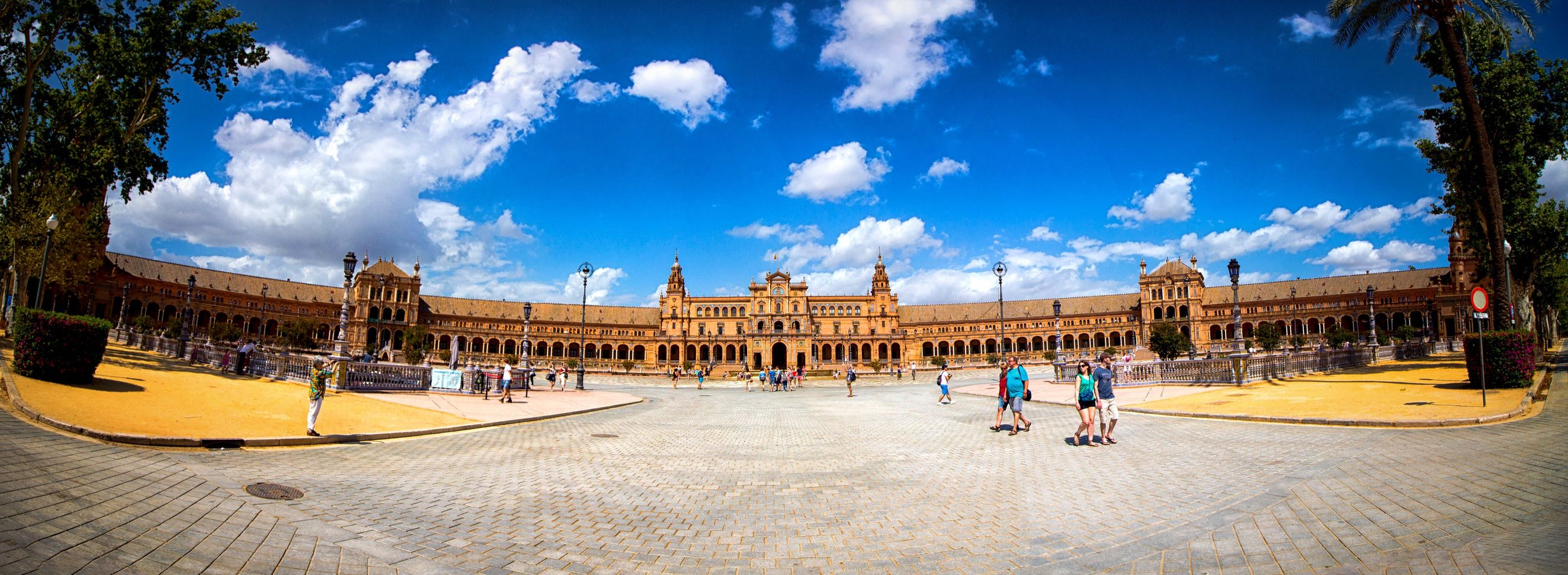 architecture, built structure, building exterior, tourism, travel destinations, famous place, travel, sky, tourist, history, international landmark, cloud - sky, capital cities, city, town square, palace, outdoors, vacations, blue, day, facade, city life, in front of, culture, government building, national landmark