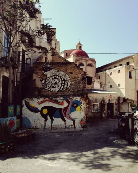 Graffiti Street Art Architecture Built Structure Building Exterior Multi Colored Outdoors Day City Sky Contrast Church Architecture Suburbs Italy Sicily Summer Palermo City Travel Destinations Vacations No People Clear Sky