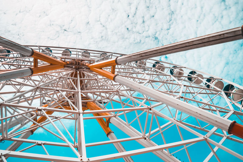 Close-up view of ferris wheel against sky