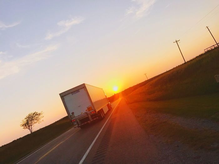 "Always Moving Forward Searching For"" That One "" Sunset Sky Road Transportation Outdoors Land Vehicle No People Nature Tree Sunlight Day Sun Been There. Grass EyeEmNewHere highway to lead you somewhere big truck hauling going away Paint The Town Yellow"