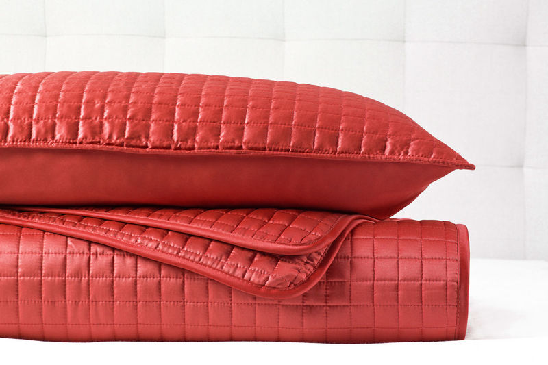 Close-up of red sofa on table at home
