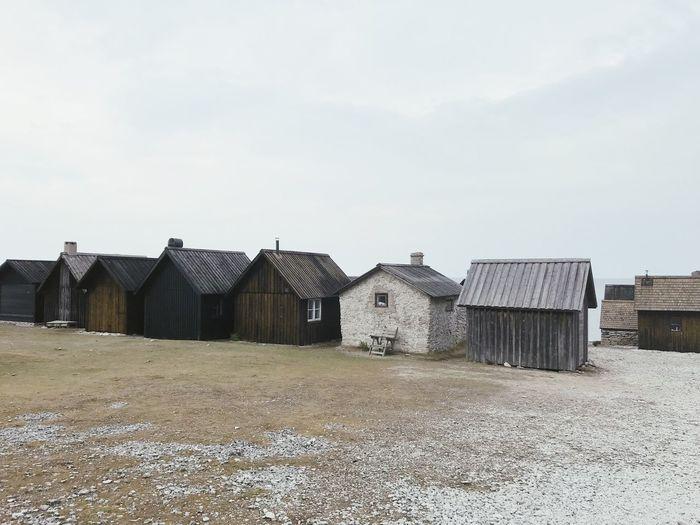 Houses against sea at beach