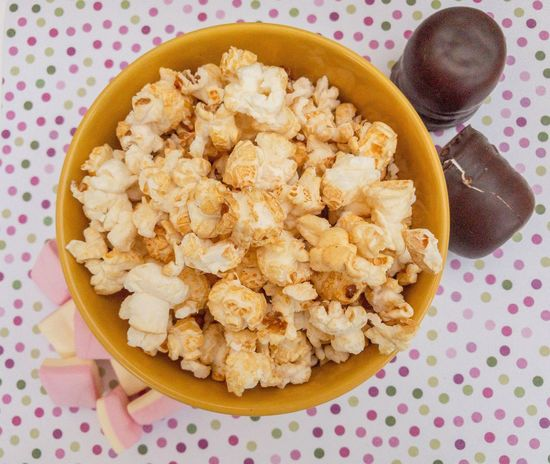 Sweets from above Food Directly Above Bowl Snack Popcorn Sweet Still Life Tasty Vegetarian Sugar Marshmallows Candies Sugary Sweet Food Food And Drink Delicious Crunchy Soft Chocolate Kiss Top View Points Unhealthy Chocolate Party Children