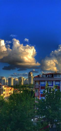 Building Exterior Architecture Built Structure Sky Cloud - Sky City Building Skyscraper Office Building Exterior Residential District Landscape Blue Tree Outdoors Plant Illuminated No People Night Cityscape Nature