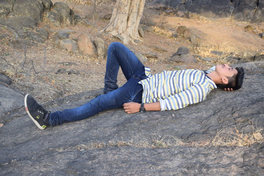 Casual Clothing Day Full Length High Angle View Leisure Activity Lifestyles Lying Down Lying On Back Nature One Person Outdoors People Real People Young Adult Young Women