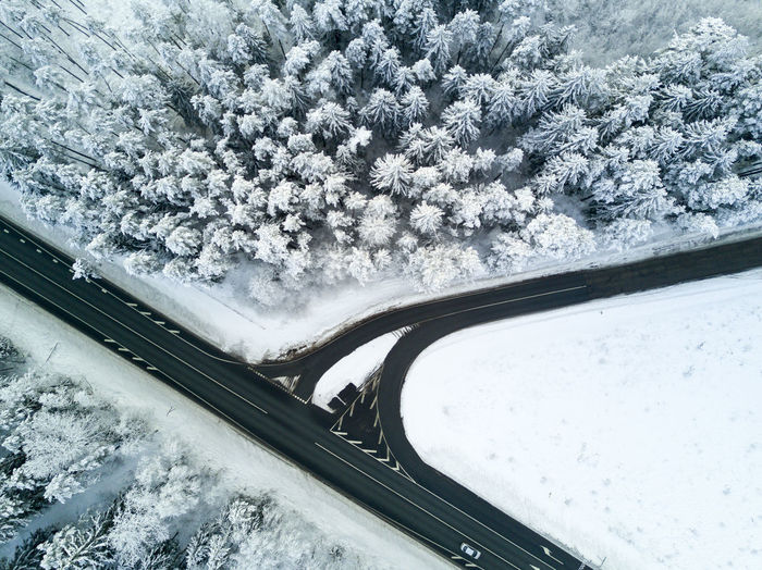 Winter road Beauty In Nature Bridge - Man Made Structure Cold Temperature Day High Angle View Land Vehicle Mode Of Transport Nature No People Outdoors Road Snow Snowing Transportation Tree Weather Winter