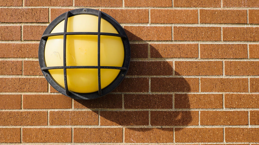 Close-Up Of Recessed Light On Brick Wall