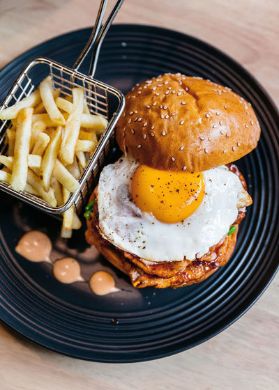 High Angle View Of Egg Burger Served On Table