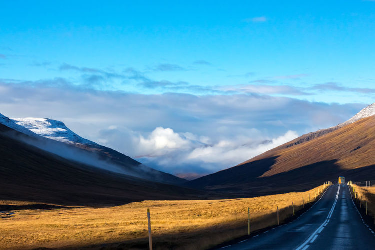 Field Iceland Traveling Beauty In Nature Bus Cloud - Sky Day Landscape Light And Shadow Mountain Mountain Range Nature No People Outdoors Road Scenics Sky The Way Forward Tranquil Scene Tranquility Transportation Clouds Goldenfield Goldenlight
