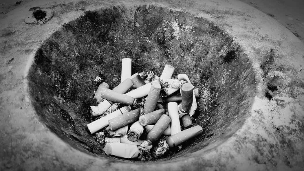 Numerous lives have been shortened. Telling Stories Differently Urban Street Photography Singapore Rubbish Bin Cigerettes Ashtray  Black & White Up Close Street Photography Crater The Street Photographer - 2016 EyeEm Awards Colour Palette Eyeemphoto Welcome To Black Black And White Friday EyeEm Ready