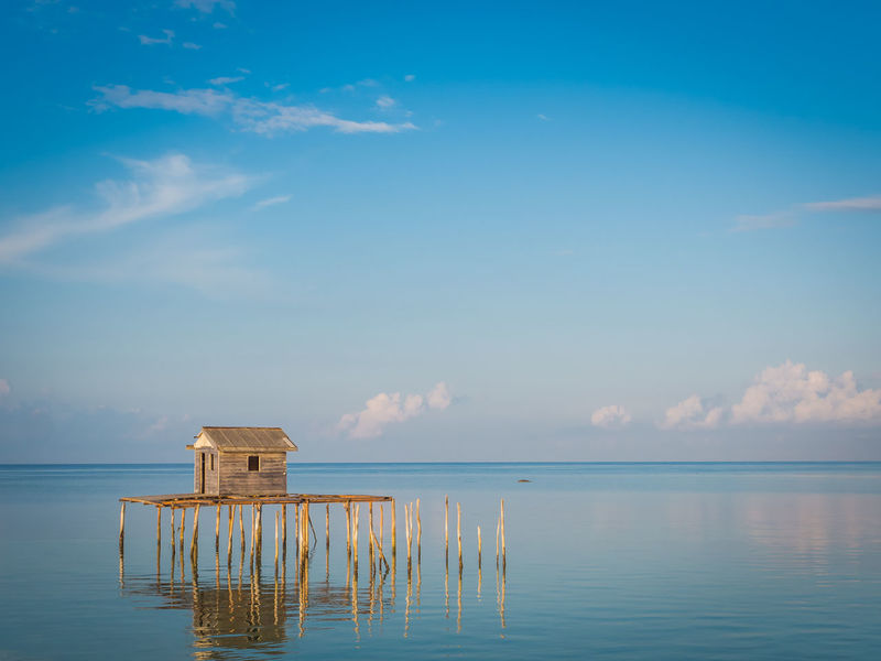 Traditional home for traditional fisherman Sky Water Cloud - Sky Scenics - Nature Tranquility Tranquil Scene Beauty In Nature Sea Nature Waterfront Reflection Horizon Horizon Over Water No People Architecture Built Structure Day Idyllic Blue Outdoors Wooden Post Jermal Bagan Traditional Fisherman