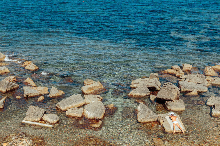 Man Mediterranean Sea Beach Beachphotography Beauty In Nature Day Italy Man Looking At Sea Man Lying On The Ground Nature One Person Outdoors Rocks Rocks And Water Sand Sea Summer Water