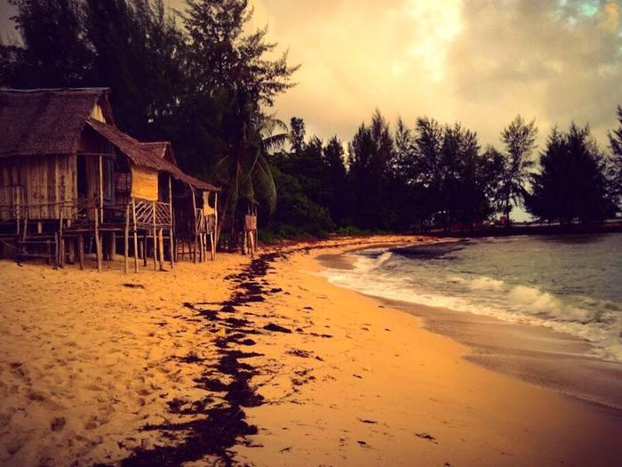 Water Nature Beach Built Structure Sand Sunset Shacks Outdoors Sky Reflections