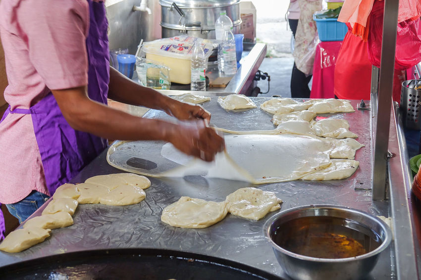 PREPARING ROTI CANAI AT RESTAURANT Asian  Breakfast Famous Asian, Background, Bread, Breakfast, Brunei, Cholesterol, Cook, Cooking, Crispy, Cuisine, Curry, Delicacy, Delicious, Dessert, Eastern, Eat, Eating, Egg, Egg Roll, Famou, Flatbread, Flour, Food, Fresh, Fried, Gold, Hot, Indian, Local, Making, Malaysian, M Day Food Food And Drink Freshness Indoors  Popular Preparing Food Roti Canai And Curries Street