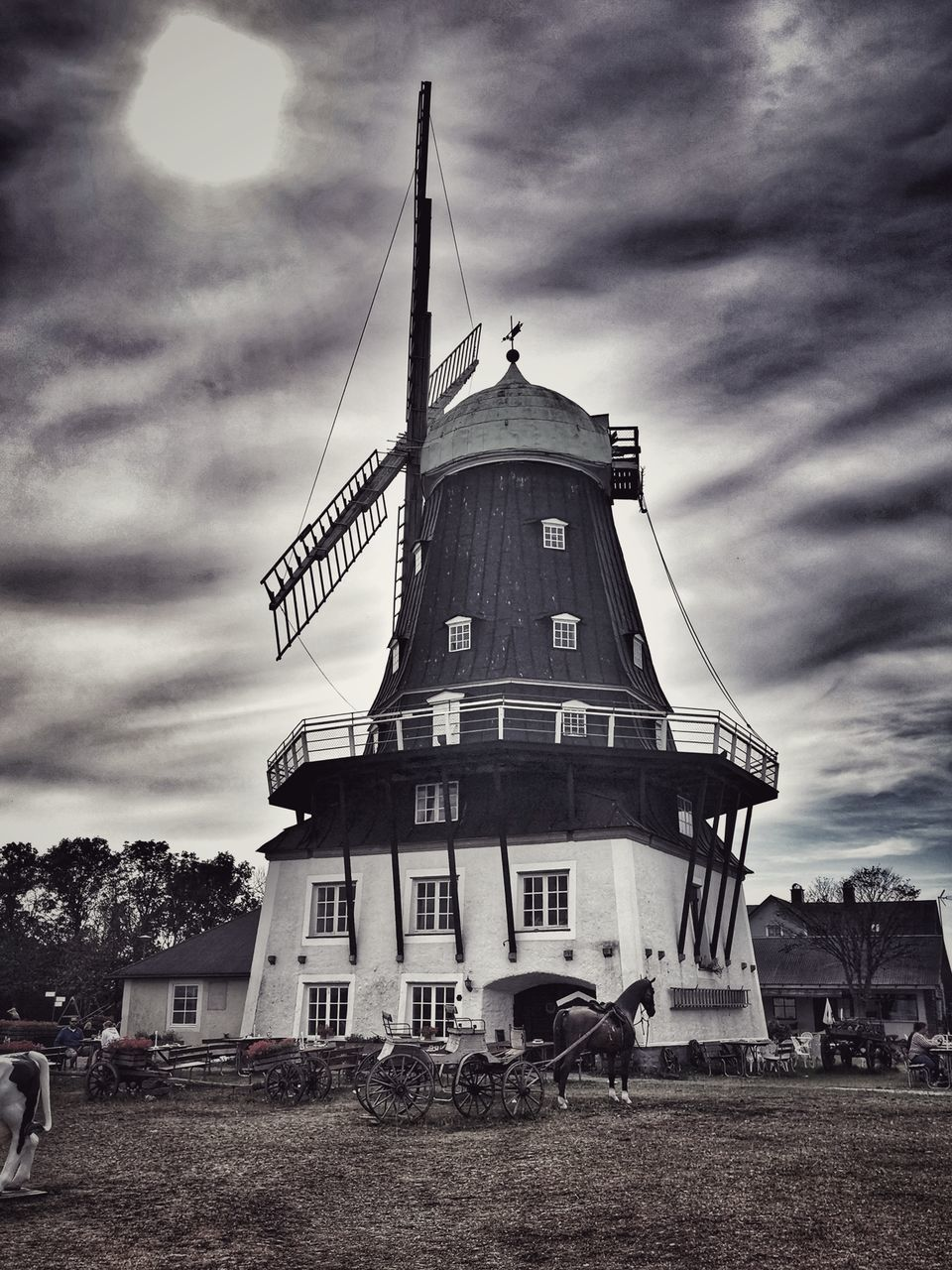 LOW ANGLE VIEW OF TRADITIONAL WINDMILL ON FIELD
