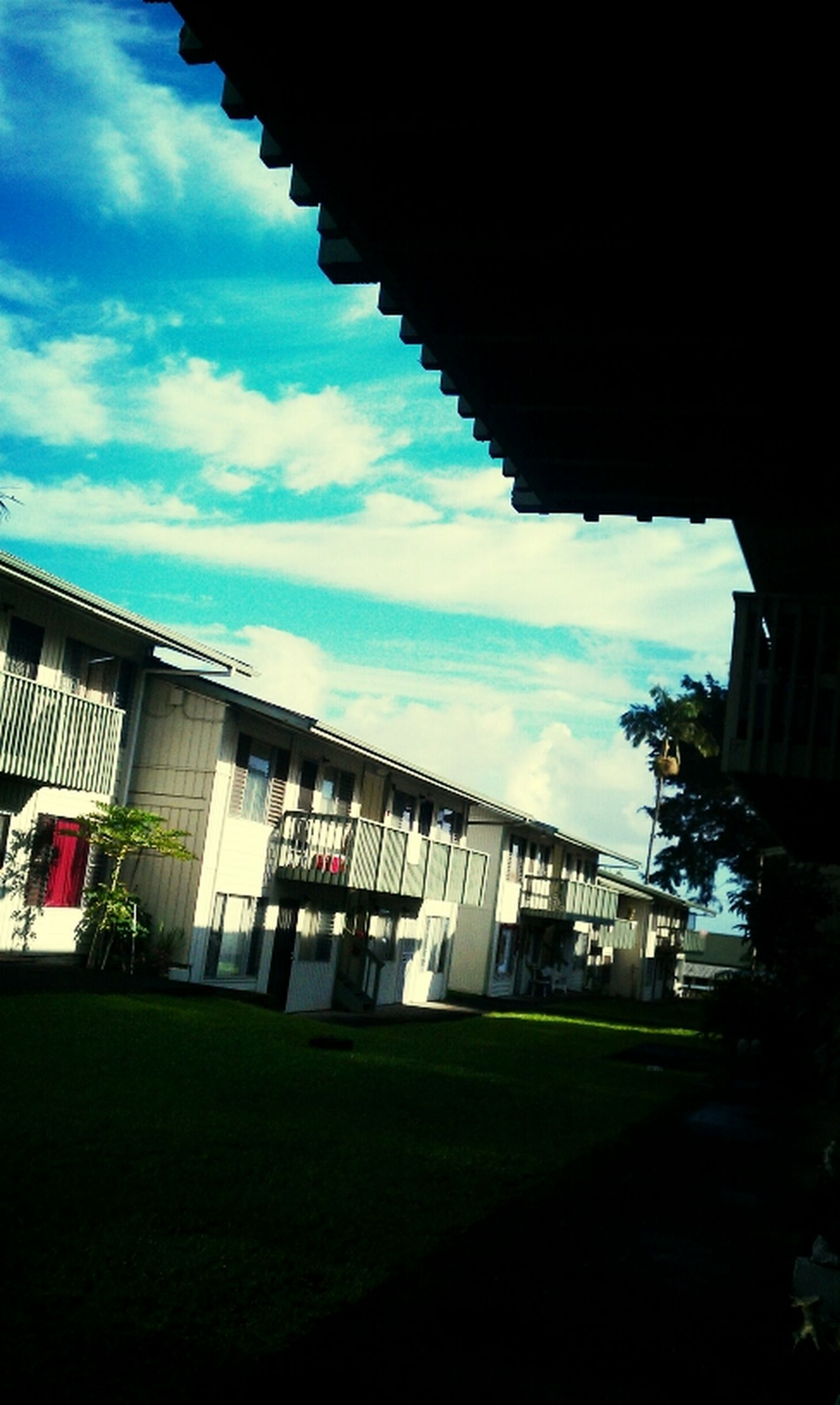 architecture, built structure, building exterior, sky, cloud - sky, house, residential structure, residential building, roof, cloud, cloudy, building, low angle view, outdoors, no people, day, window, nature, sunlight, tree