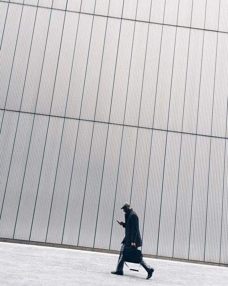 Streetphotography Strideby Angle Uphill Walking Man Street Photography Minimalism Minimal Minimalobsession Minimalist Architecture Modern One Person City Life On The Way Going To Work The Street Photographer - 2016 EyeEm Awards
