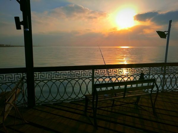 Fishing clears the mind. ❤ Fishing Fishing Spot Fishing Rod Sunrise Cloudy Sunrise And Clouds Wooden Chair Sea Sea And Sky Seascape Sea View Beautiful Morning Finding New Frontiers