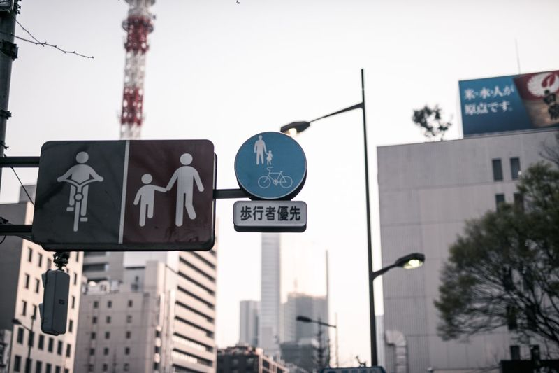 Low angle view of road sign against buildings