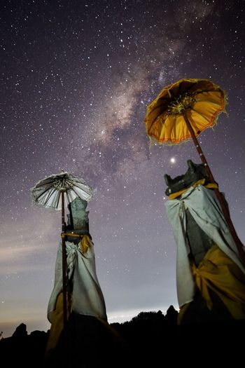 Hinduism statue in front of a beautiful night sky with the milkyway on bali