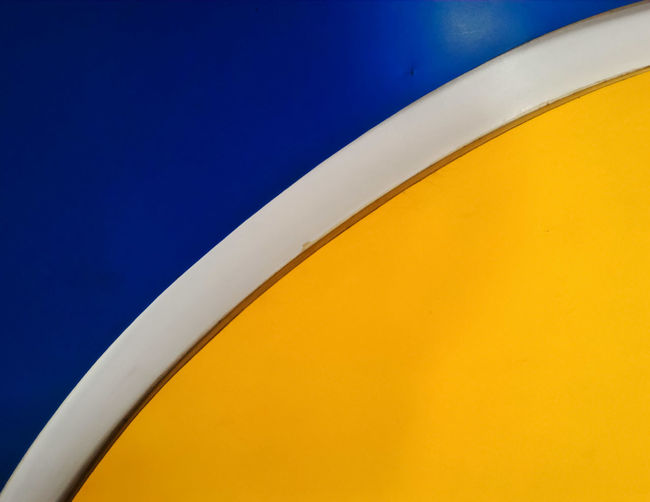 Close-up of yellow and blue wall design